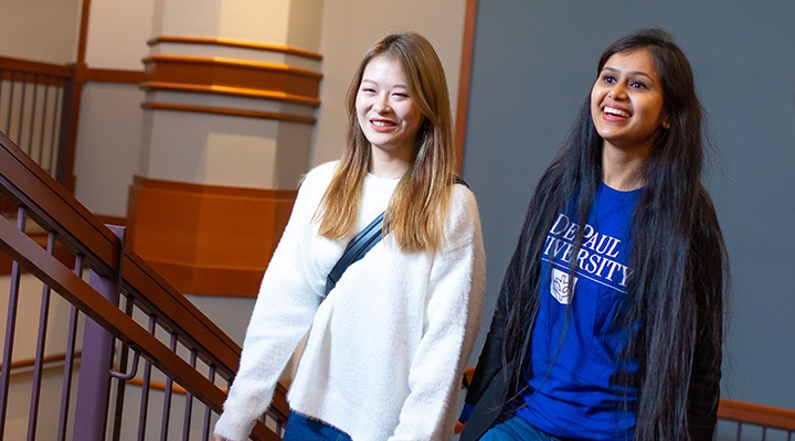 Two DePaul students on a staircase